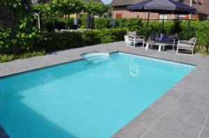 zwembad aanleggen ronde trap